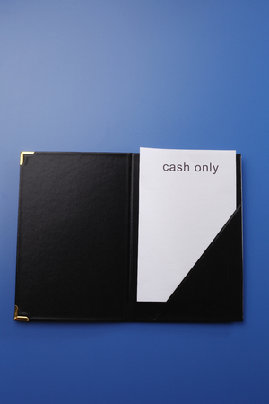 close of the gratuity on the blue background 版權商用圖片
