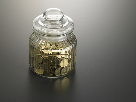 close up of the coins in a glass jar