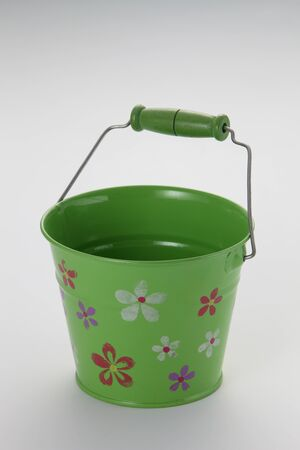 green color bucket on the white background