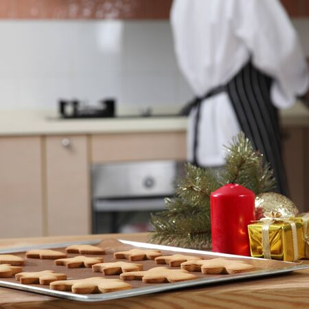 tray of cookies and chef preparing icing sugar