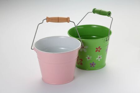 pink and green color water pail