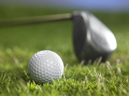 golf ball and golf club on the grass Stock fotó