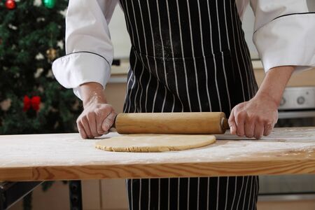 hand with rolling pin and flour Banque d'images