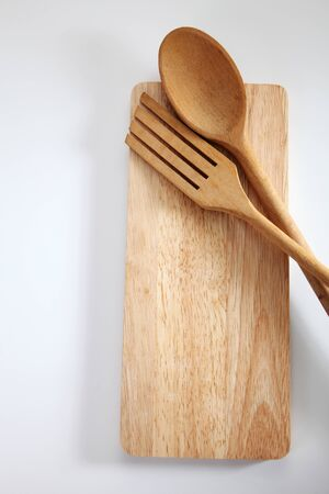 Wooden spatula and spoon  on the chopping board