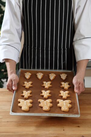 chef holding a tray of cookies