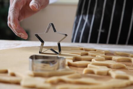 chef is taking a star shape cutter 스톡 콘텐츠