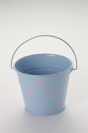 blue color pail on the white background