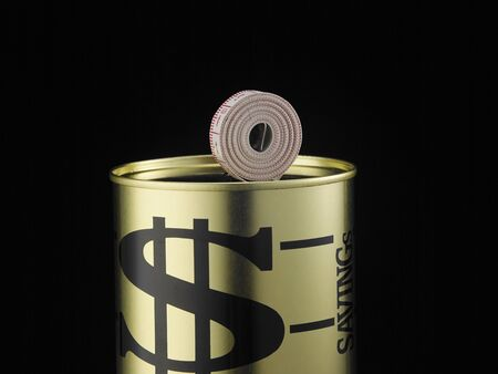 measuring rolled up as a coin on money box