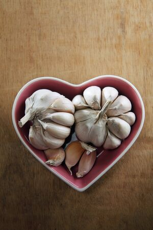 white garlic in the heart shaped bowl