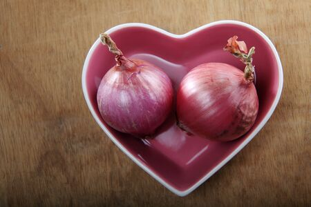 onions in a heart shaped bowl