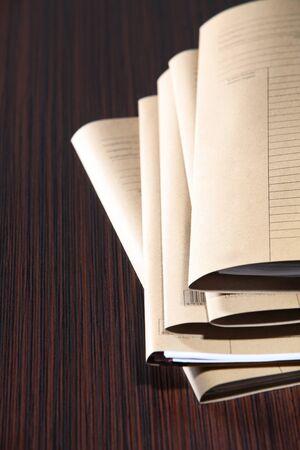 stacks of brown paper files