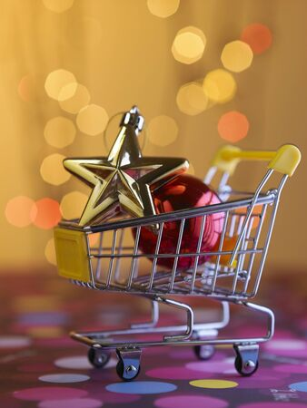 mini shopping cart with christmas ornaments
