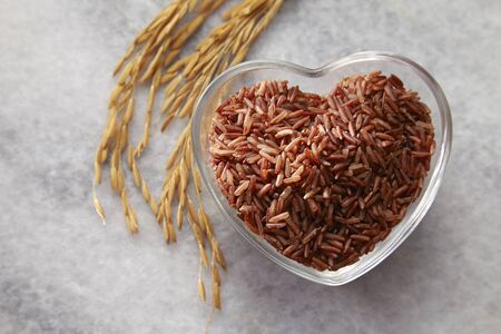 brown rice in a heart shape cointainer