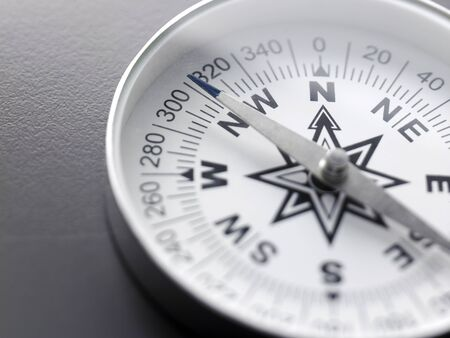 close up white compass on the gray background 스톡 콘텐츠