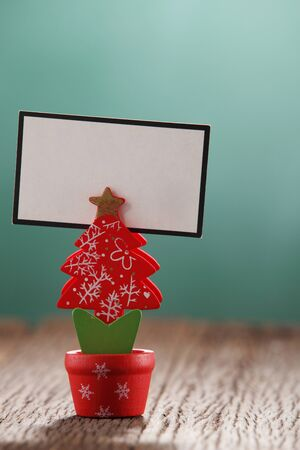 handmade christmas tree holding blank card