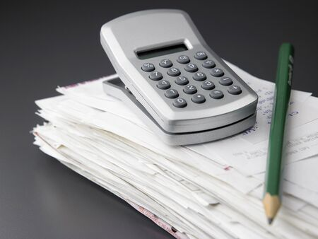 stack of  bill and calculator Stock fotó