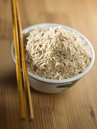 brown rice in the bowl with chopstick Stock fotó - 129776192
