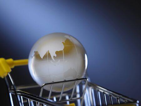 glass globe on the mini shopping cart