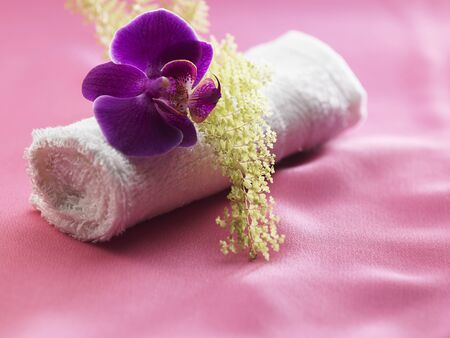 concept of spa - towel and orchid Stock fotó