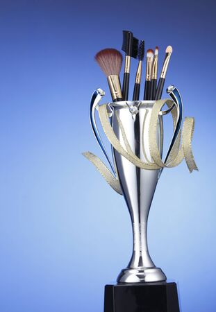 brushes in the trophy on the blue background Stock fotó