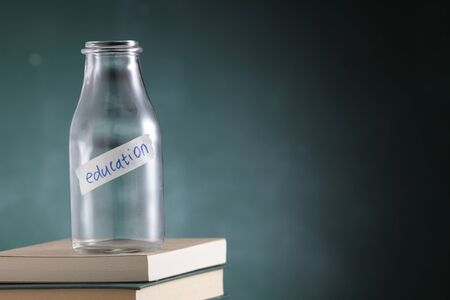 empty glass jar labelled with text education