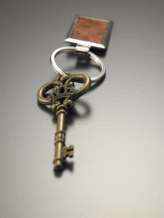 old key with blank silver tag