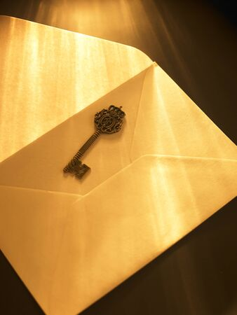 ray of light fall on key and envelope