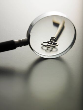 magnifying glass on a key Stock Photo