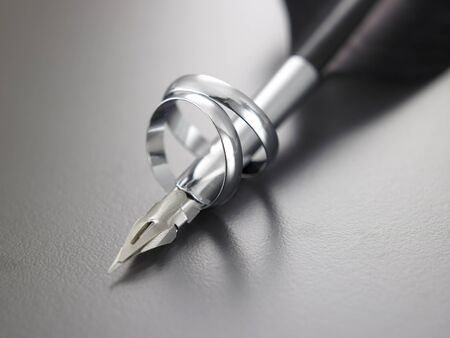 close up of the ring and quill pen