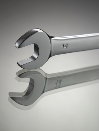 wrench on the gray background with reflection
