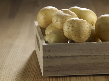 potato in the wooden create