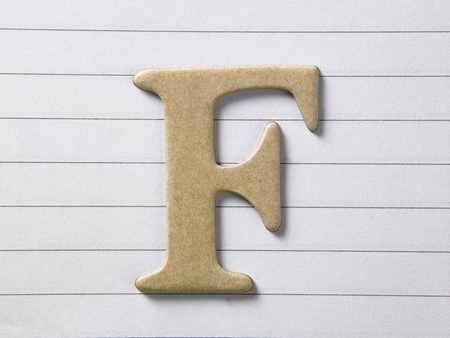 close up of alphabet f on single line book