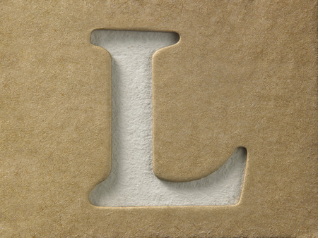 cut out alphabet l on the brown cardboard