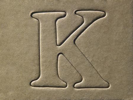 die cut alphabet k on the brown card board