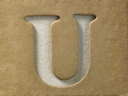 cut out alphabet u on the brown cardboard Stock Photo