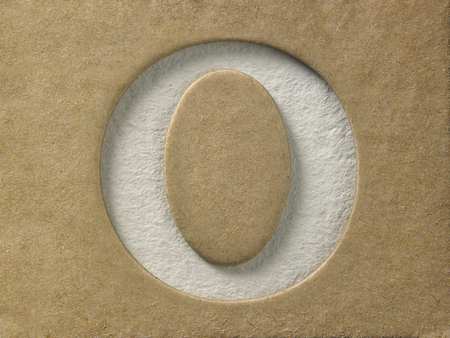 cut out alphabet o on the brown cardboard Stock Photo