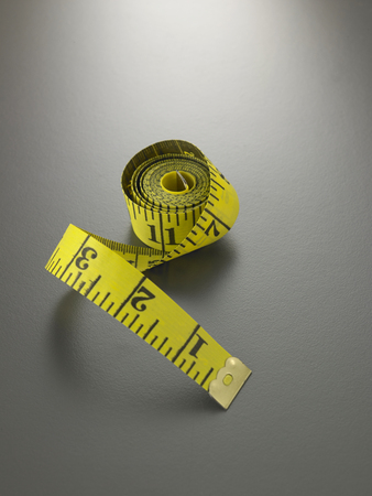 measuring tape on the gray background Stock fotó