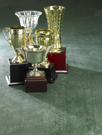 Group of trophy on the green background