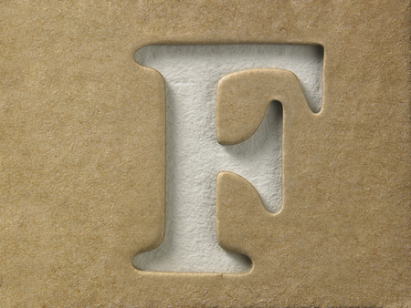 cut out alphabet f on the brown cardboard