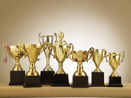 group of trophies on the table Stock Photo