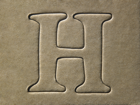 die cut alphabet h on the brown card board