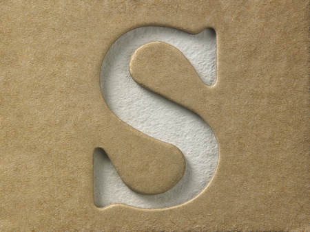 cut out alphabet s on the brown cardboard Stock Photo
