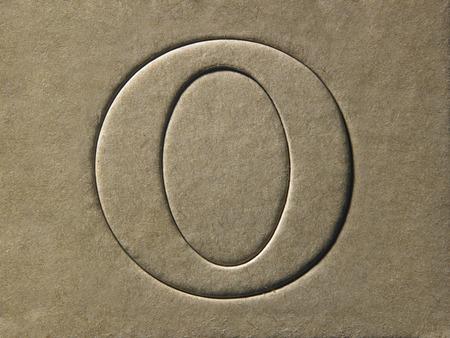 die cut alphabet o on the brown card board Foto de archivo