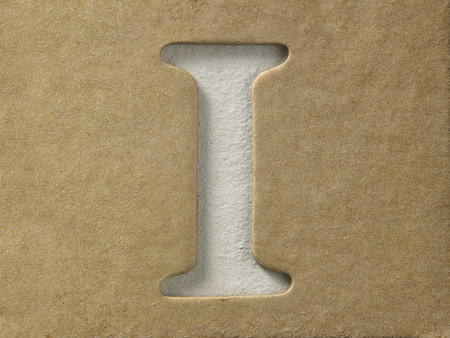 cut out alphabet i on the brown cardboard