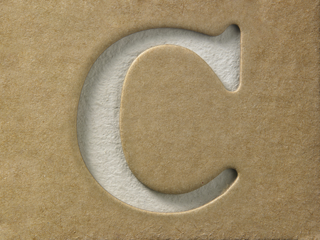cut out alphabet c on the brown cardboard Stock Photo