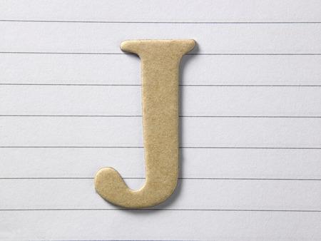 close up of alphabet j on single line book