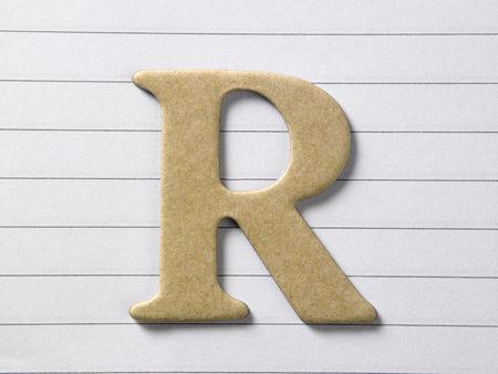 close up of alphabet r on single line book Foto de archivo