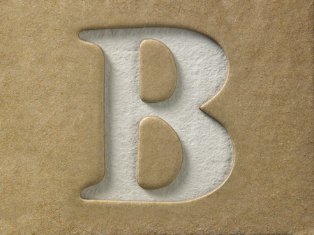 cut out alphabet b on the brown cardboard Archivio Fotografico