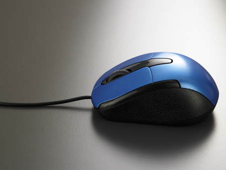 blue color wired mouse on the gray background