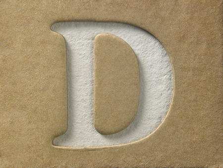 cut out alphabet d on the brown cardboard Stock Photo